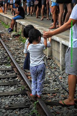 children walking on Rail lines, Tanjong Pagar Raiway Station, Singapore