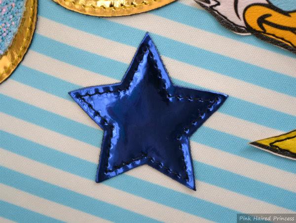 irregular choice whoa bag blue metallic star applique to front