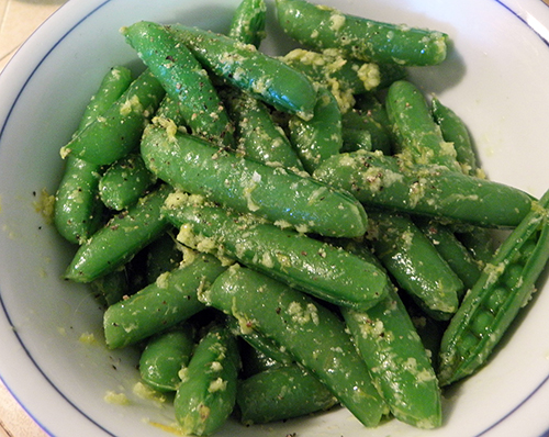 Snap Peas with Ginger and Lemon in Serving Dish
