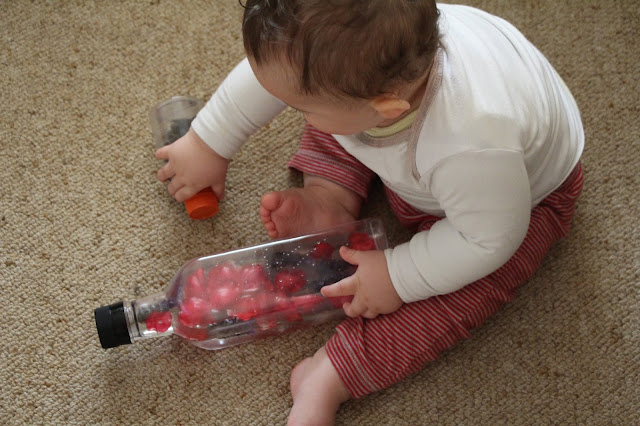 Baby exploring discovery bottles