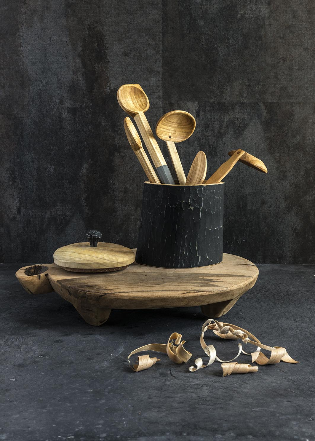 Hand carved spoons in a wooden pot with lid by Will Priestley.