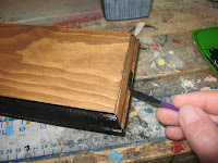 Painting the decorative edge with black paint