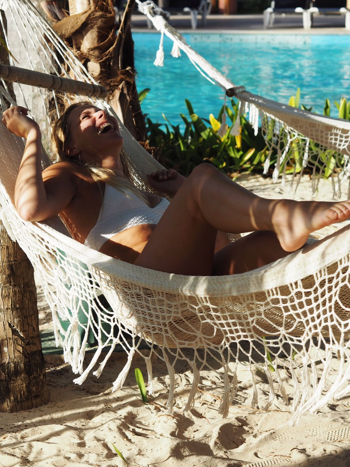 Rachel Emily White Bikini Laughing in Hammock by Pool