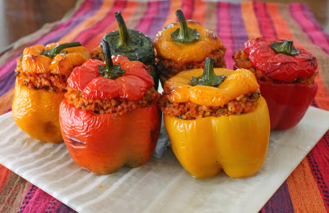 Food Lust People Love: These colorful roasted peppers are stuffed with a hearty filling of nutty bulgur wheat and tomatoes, seasoned with onion, parsley and cilantro, perfect as a side dish or main course.