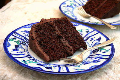 Vegan Chocolate Cake is dense and moist. The frosting is fudgy and delicious.