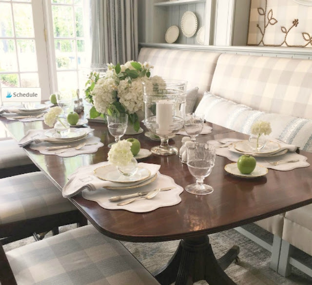 Blue and white checks on banquette and vintage table in breakfast room of Southeastern Designer Showhouse 2017