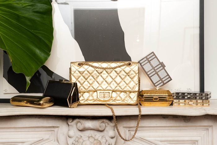 Mary Alice Stephenson gold Chanel purse and gold designer purses