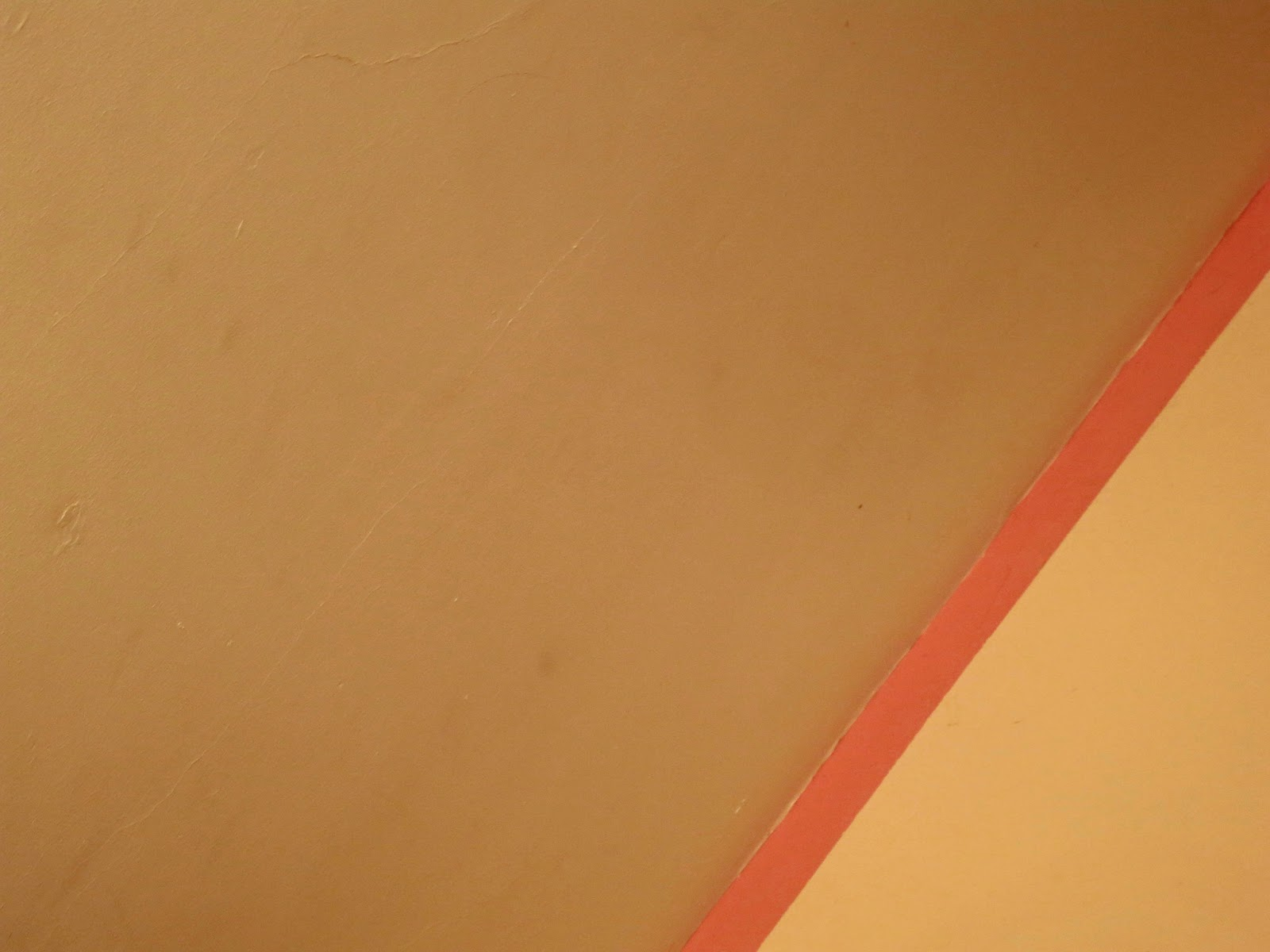 Where the slope of a ceiling meets the wall. Pink paints.