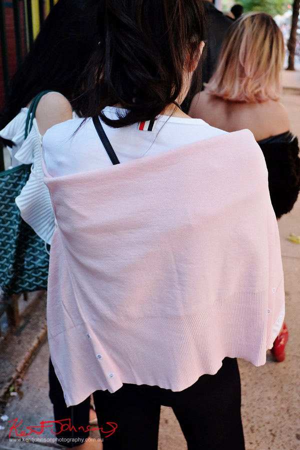 Details - Light pink cardigan wrapped over white tee. Street Fashion Sydney - New York Edition photographed by Kent Johnson