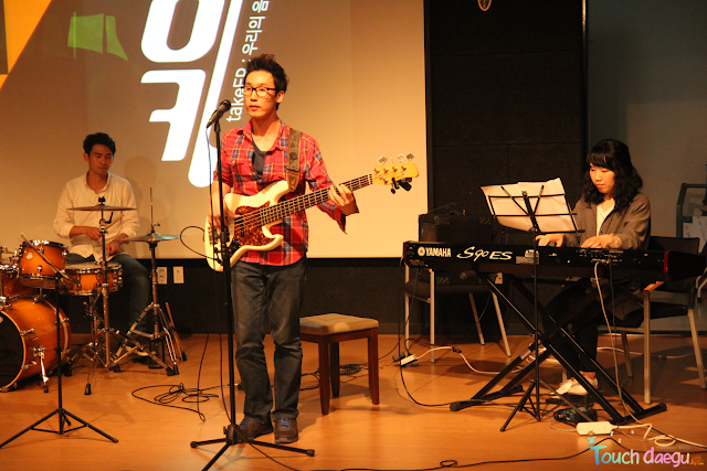 A singer of Takin sing a song with guitar on the stage of Daegu Art Factory
