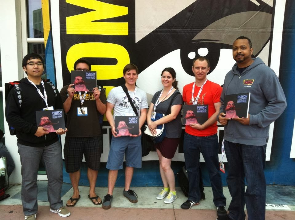 A picture of Punch Drunk Mustache artists at comicon including Sean Pando