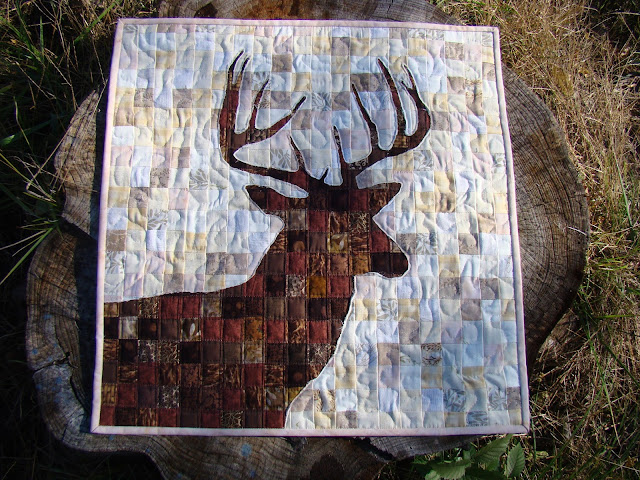 Reverse applique deer quilt