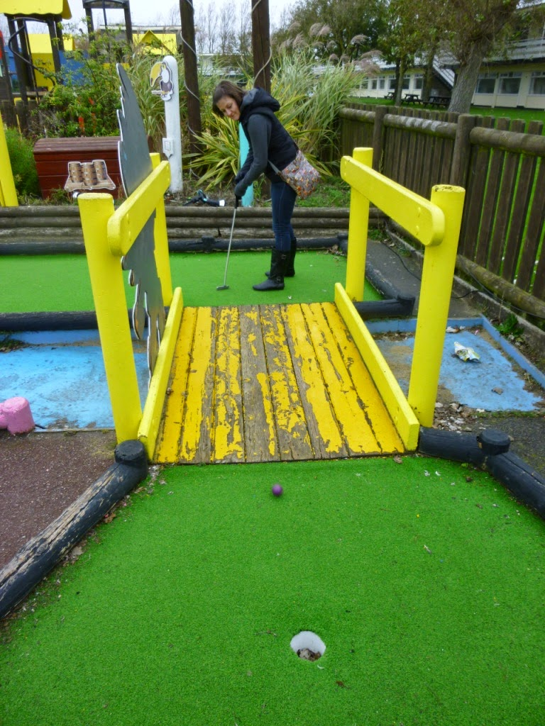 Emily Gottfried playing the Crazy Golf course at Pontins Camber Sands Holiday Park