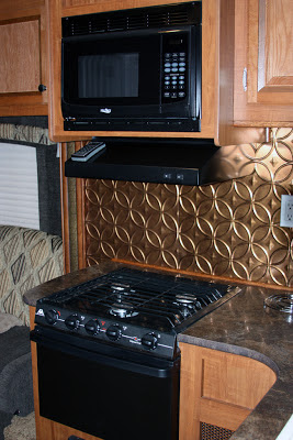 Stove and range hood with panel