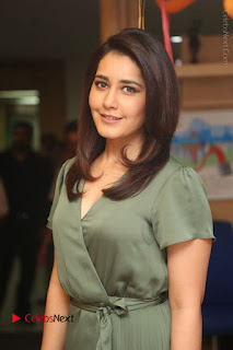 Actress Raashi Khanna Stills in Green Short Dress at Mirchi 95 Suno Aur Mercedes Jeeto Contest  0030.JPG