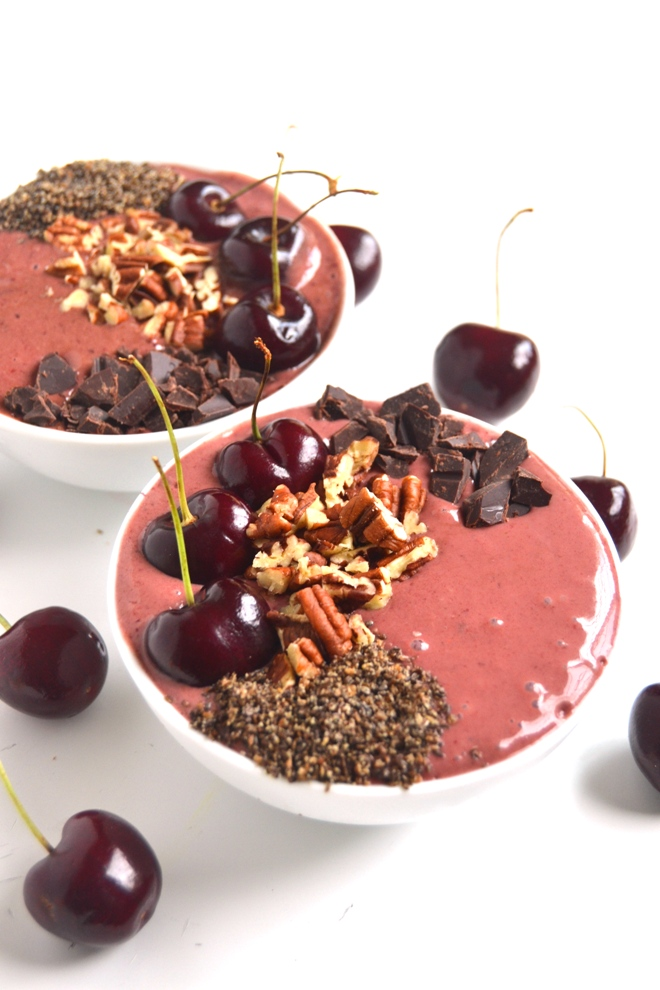 Chocolate Cherry Smoothie Bowls take 5 minutes to make and are the perfect breakfast, snack or dessert. Loaded with cherries, cocoa, banana and cherry yogurt and topped with fun toppings! www.nutritionistreviews.com
