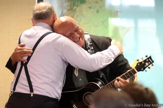 Cr Rex Graham, Hastings, new chairman, hugs Hastings District Councillor Henare O'Keefe, at the first meeting of the new Hawke's Bay Regional Council, Napier. photograph