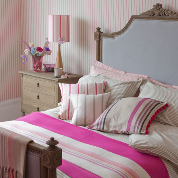 pink stripe bedding in country cottage bedroom