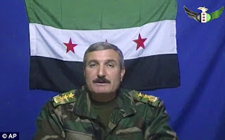 """COLONEL AL-AS'AD ANNOUNCES NEW """"CHEAPER SYRIAN ARMY""""; 2"""