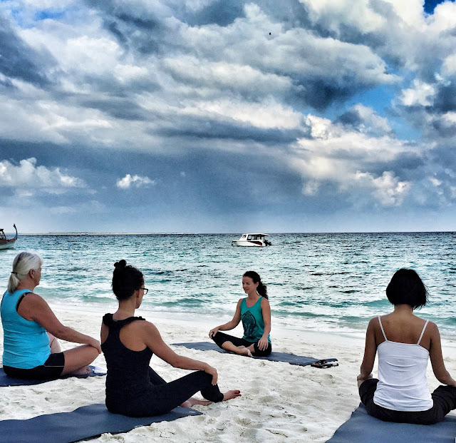 The Barefoot Eco Hotel Yoga at the beach