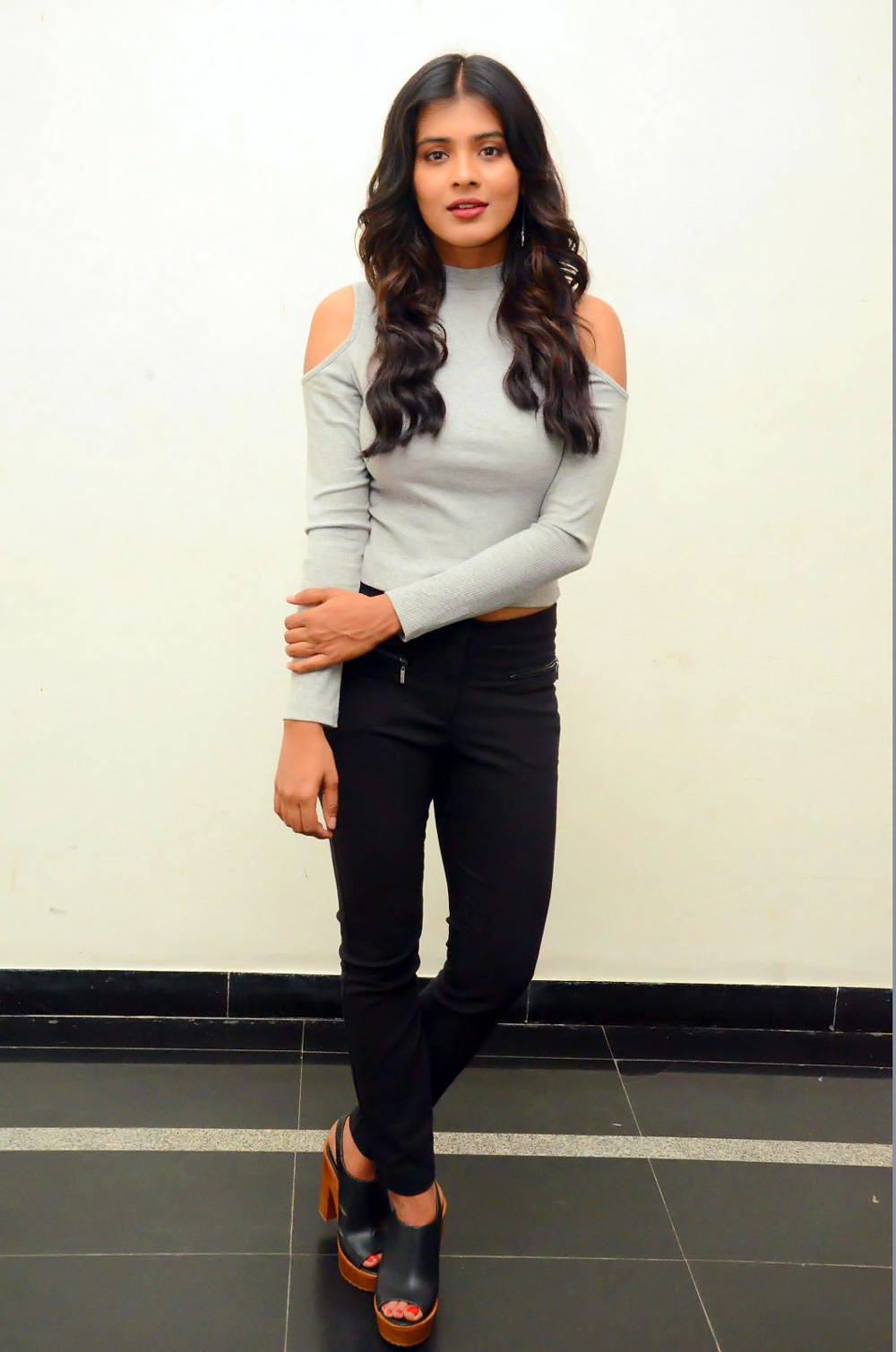 Hebah Patel Stills At Movie Launch In White Top Black Jeans