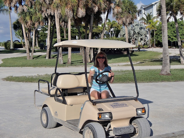 Susan in golf cart