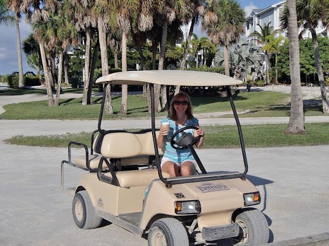 Susan in golf cart