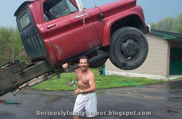 funny-strong-man-lifting-truck