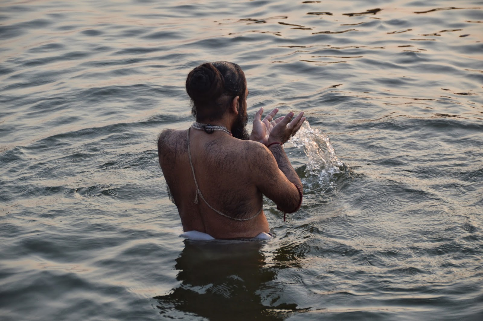 Varanasi Things to do morning bathing sadhu naked male man priest ghat