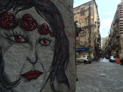 Street art on walls around central Palermo.