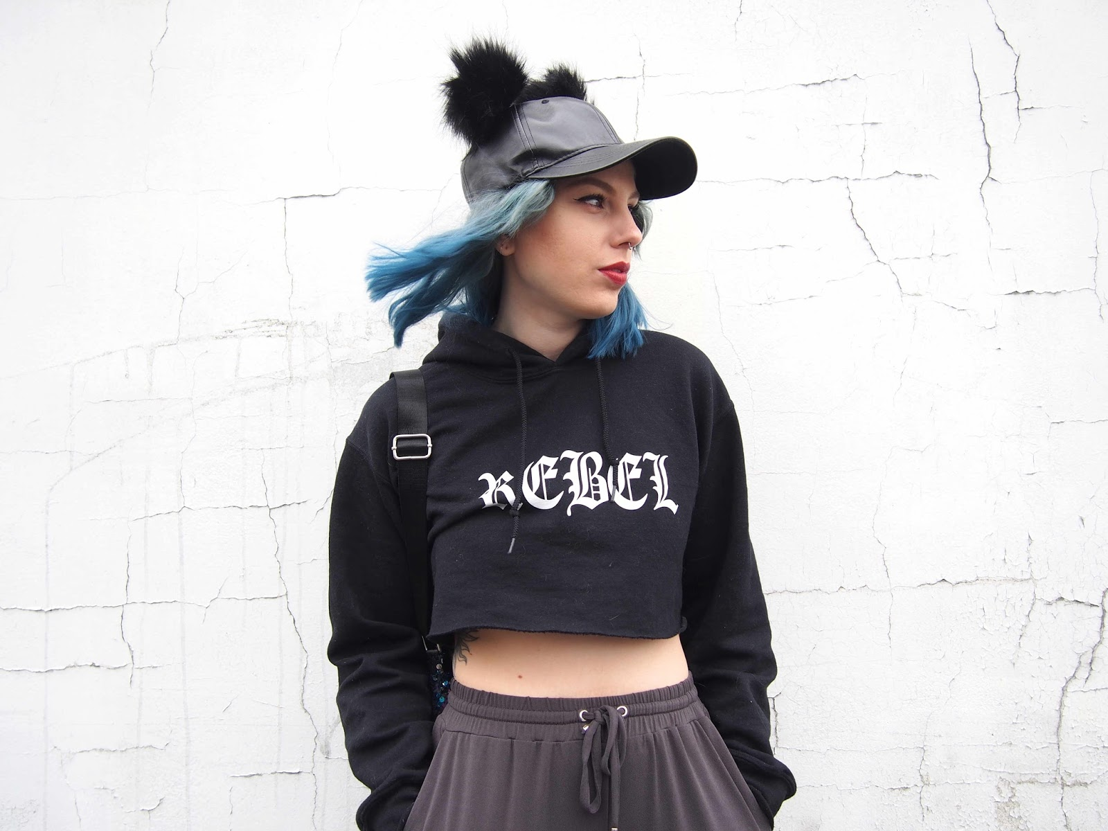 how to style joggers, outfits with joggers, jogger outfits, cropped hoodie, black cropped hoodie, black pom pom hat, hat with pom pom, sequin bag, sequin backpack, pom pom hat