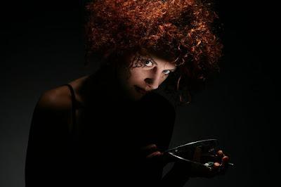 redheaded woman full of curls.jpeg