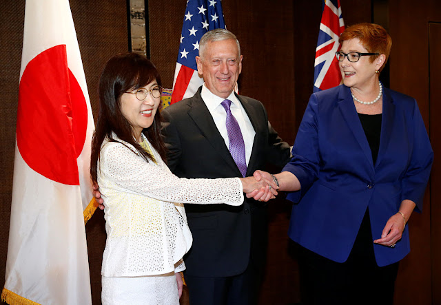 Image Attribute: Japan's Defence Minister Tomomi Inada, U.S. Secretary of Defense James Mattis and Australia's Defence Minister Marise Payne pose before a trilateral meeting on the sidelines of the 16th IISS Shangri-La Dialogue in Singapore June 3, 2017. REUTERS/Edgar Su