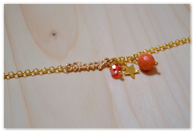 bracelet happy, breloque étoile et perles à facettes
