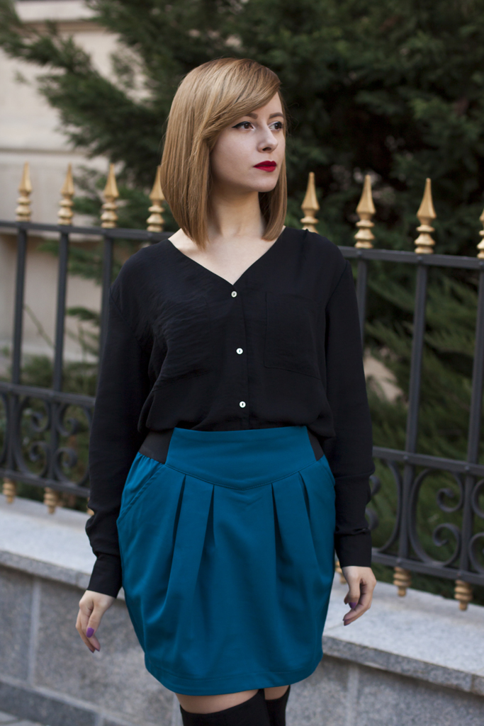 black blouse and blue skirt