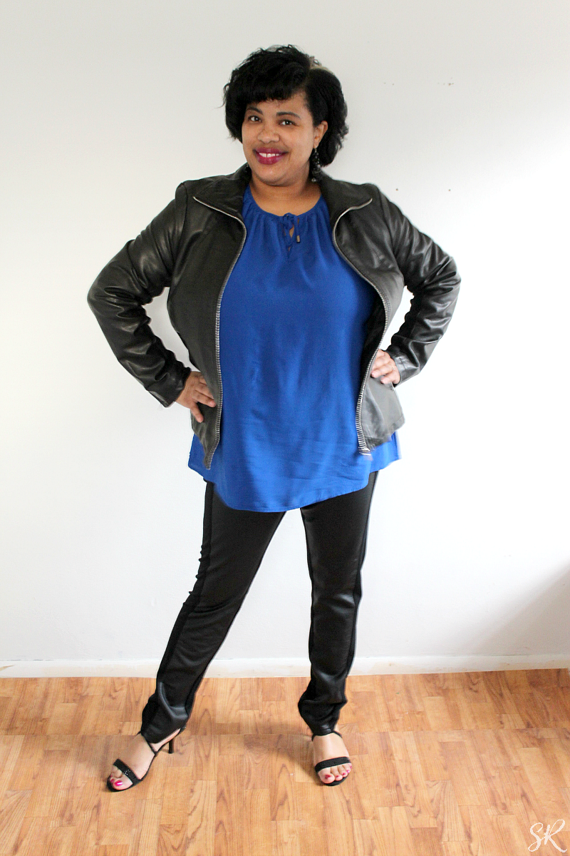 a woman wearing a blue and black outfit