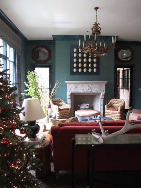 Deep green teal walls in living room - Gorgeous Christmas decorations at elegant Home for Holidays showhouse in Atlanta - Hello Lovely Studio
