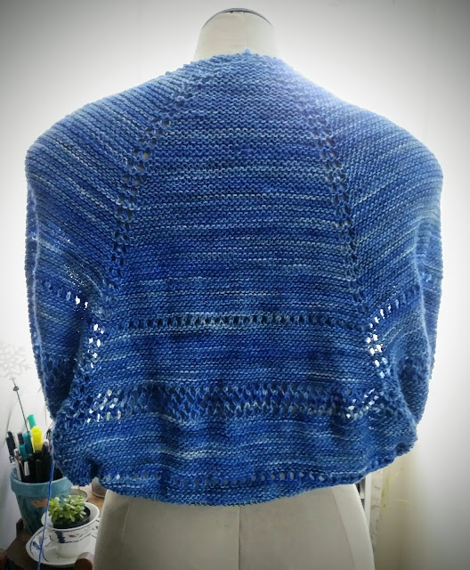 Knitting a prayer shawl with purple Manos Del Uruguay yarn