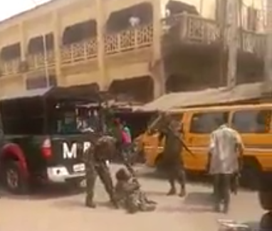 Image result for Nigerian Army arrested two soldiers who brutalized a crippled Civilian photos