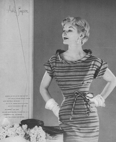 Model in casual Adele Simpson striped dress for  April 1953 Vogue