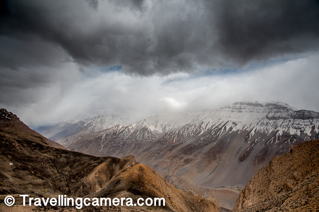 This place is 2 km from Hikkim village in the Spiti Valley. This gompa is located on high altitude facing some huge snow covered mountains on the other side. While we were walking around the place, we noticed storms and snowfall on some of these hills. Suddenly the sun went away and the chill in winds went up abruptly. We had multiple experience like this in Spiti when it comes to weather change here we could also witness some visual evidences of the activities which lead to such changes in the valley.     Related Post - How to reach Spiti Valley from Delhi and things to do around Kinnaur/Spiti in Himachal Pradesh
