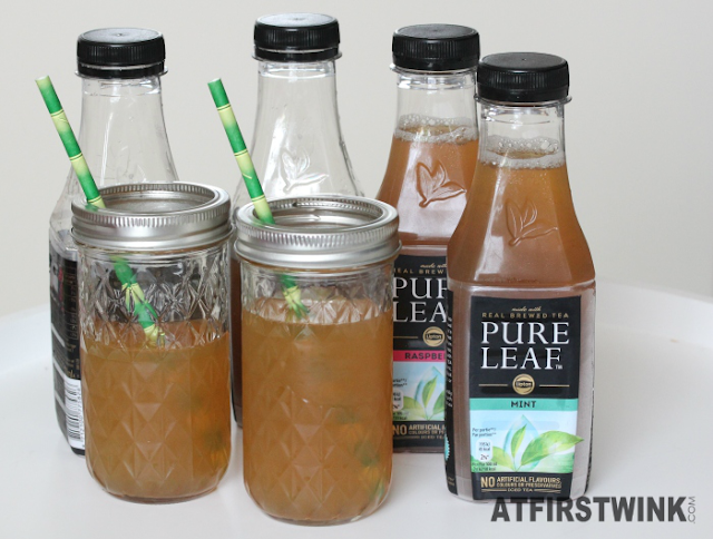 Pure leaf ice tea mint, raspberry, peach, lemon in glass mason jars with bamboo straws