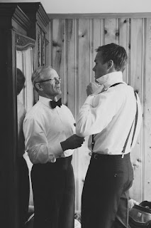 Father of groom tender moment helping son with bow tie