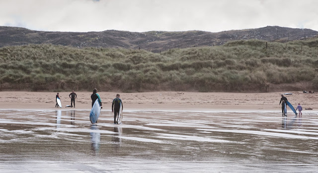 Surfers on Farr Beach; Bettyhill, Scotland