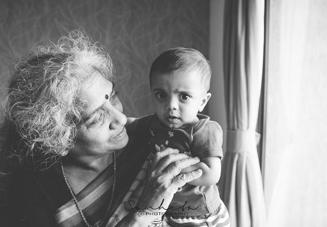 Old lady holding her great-grandchild