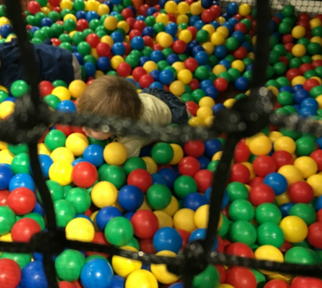 Mambo-Soft-Play-Cardiff-A-Toddler-Explores-image-of-toddler-in-ball-pit