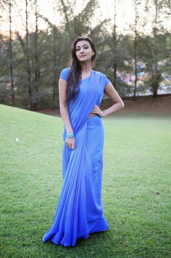 Hot Neelam upadhyay hot photo gallery in wet blue saree