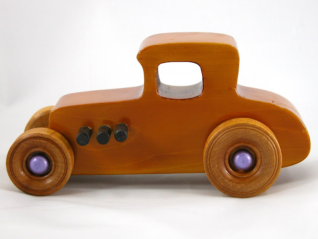 Left Side -  Wooden Toy Car - Hot Rod Freaky Ford - 27 Coupe - Pine - Amber Shellac - Metallic Purple Hubs