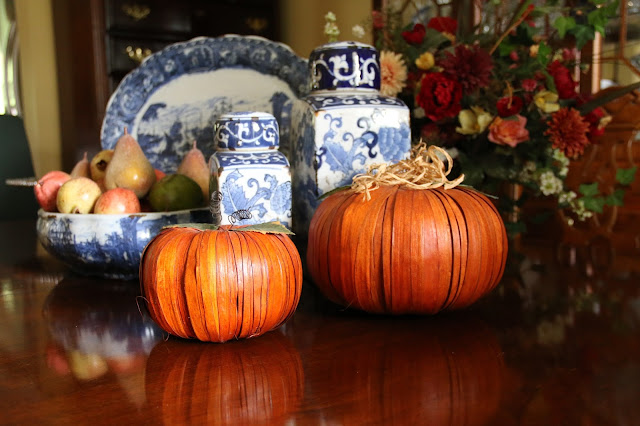 pumpkins with blue and white china