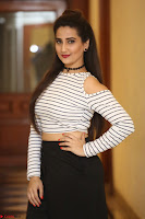 Manjusha in sleevelss crop top and black skirt at Darshakudu pre release ~  Exclusive Celebrities Galleries 092.JPG